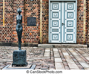 Old cityhall in Holstebro, Denmark with famous staue of...