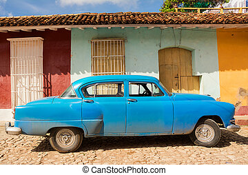 Old classic fifties car in a street of Trinidad