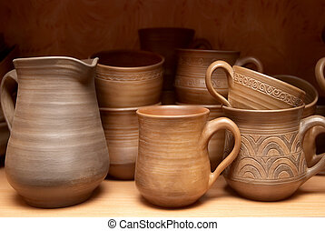 Old clay pots - Many handmade old clay pots on the shelf.