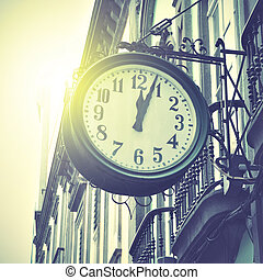Old clock at railway station. Retro style filtred image