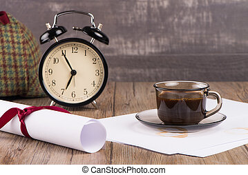 Old clock, hat, coffee and paper sheets
