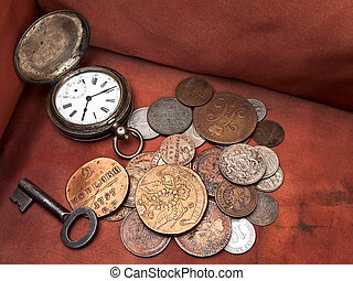 Old clock, key and coins