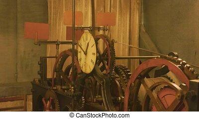 Old clock mechanism. Clockface and cogwheels. The power of...