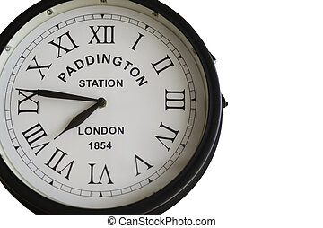 Old clock of Paddington Station in London with roman numbers