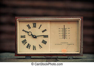 Old clock on a wooden background
