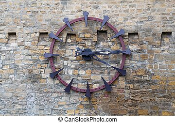 Old clock on the old wall