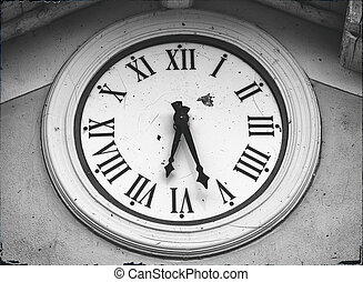 old clock on the wall monochromatic