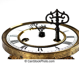Old clock with roman numerals and key.. - Mechanism of old...