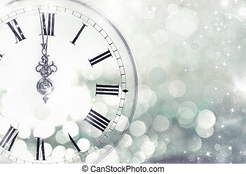 Old clock with stars and snowflakes - New Year's at midnight...