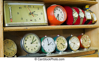 Old clocks on a shelf