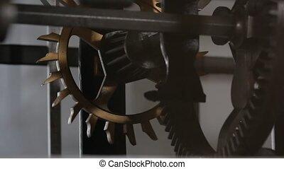 Old Clockwork Ticking - Old clockwork cogwheels close up