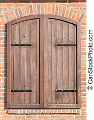 Old closed window wooden shutters