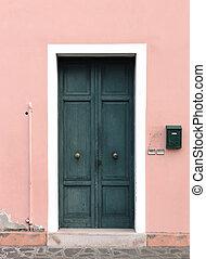 Old closed wooden door
