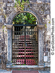 Old closed wrought-iron gates
