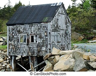 old rustic coastal shack in Little harbor Lunenburg County Nova Scotia Canada