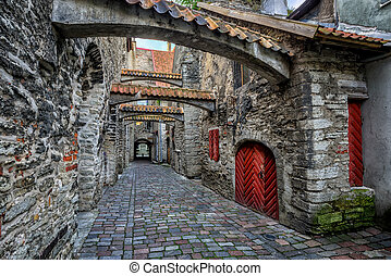 Old cobbled street in old town of Tallinn, Estonia - The St...