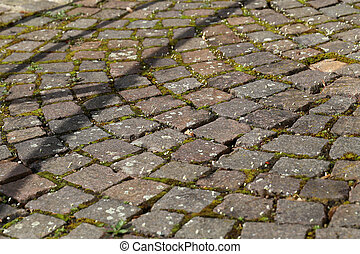 Old cobbled surface of the road in the city