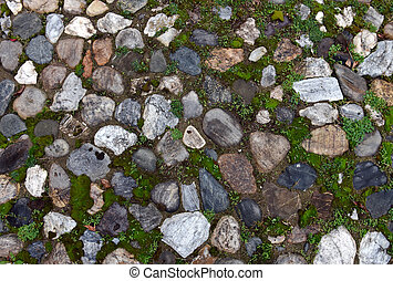 Old cobblestone background with grass