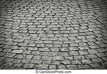 old cobblestone street in perspective and low light.