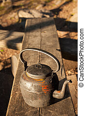 Old coffee pot in camping site