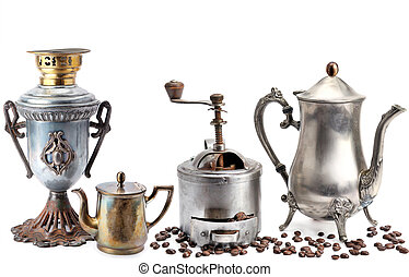 Old coffee pot, samovar, grinder coffee and beans isolated on white background.