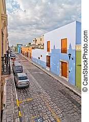 Campeche, Mexico - April 19, 2014: downtown street with typical colonial buildings in Campeche, Mexico. The city was founded in 1540 by Spanish conquistadores atop pre-existing Maya city of Canpech