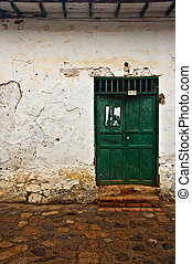 Old Colonial Wall with a Green Door