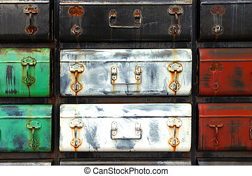 Old colourful suitcases background