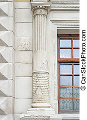 old columns on a building with a crack