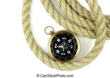 Old compass and rope on white background.