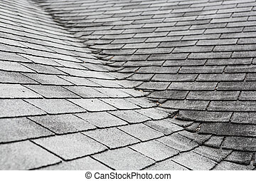 Old composite roof with damage
