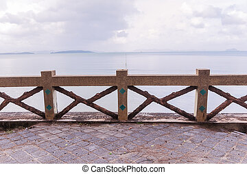 Old concrete fence with sand wash finishes at beach
