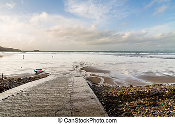 Old concrete slipway on stormy day. Broad Haven, Pembrokeshire, Wales, United Kingdom