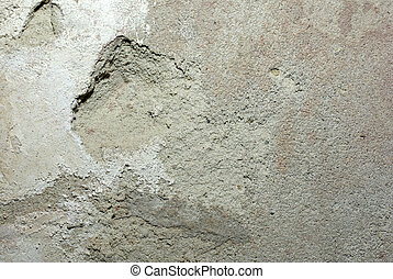 Old concrete wall with damaged plaster and alabaster on it. Abstract grunge background.