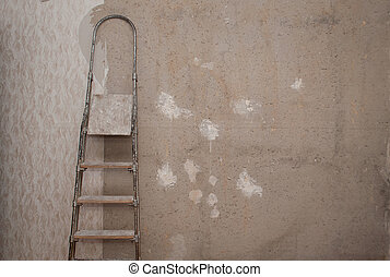 Old concrete wall with torn Wallpaper.