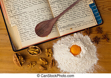 an old, hand-written cook book with recipes. old recipes.