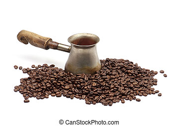 old copper coffee pot with coffee beans isolated on white