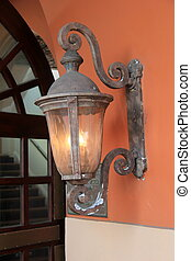 Old copper lantern on terra cotta