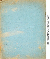 Old copybook cover page made of recycled paper. Rough fibrous paper texture with fading stains