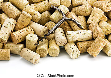 Old corkscrew and wine corks - Old corkscrew on a heap of...