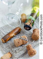 Old corkscrew, glasses and wine corks.