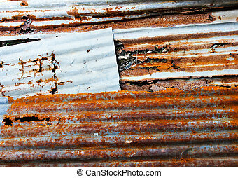 Old corrugated iron fence for background.