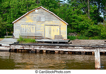 Old cotage with a wooden dock