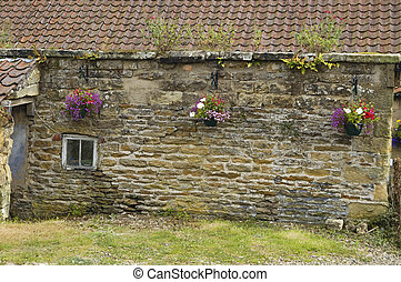 Old cottage wall and flowers