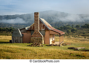 Old country homestead as the morning fog lifts - Old country...