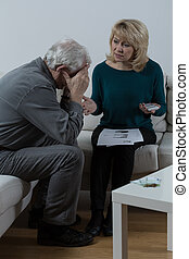 Old couple and financial problems - Old couple sitting by...