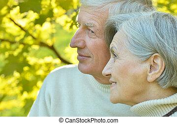 Old couple at autumn park