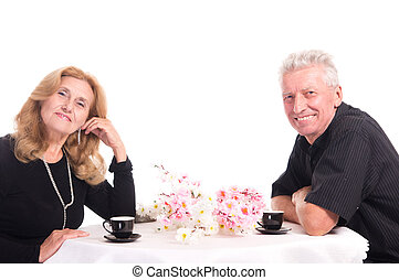 old couple at table