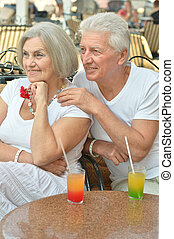 Old couple drinking juice