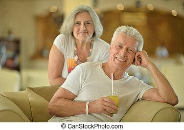 old couple drinking juice